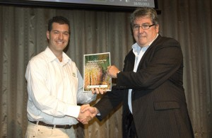 Greg Fraser, Plant Health Australia Executive Director and CEO (Right) presenting the third version of the IBP to Dr Anthony Kachenko, NGIA Environmental and Technical Policy Manager (Left).